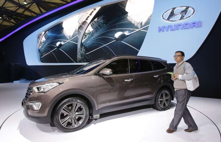 The new Hyundai Grand Santa Fe is displayed at the Shanghai International Automobile Industry Exhibition (AUTO Shanghai) in Shanghai, China Sunday, April 21, 2013. (AP Photo/Eugene Hoshiko)