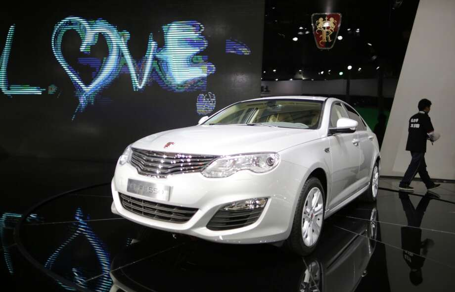 The Roewe 550 is unveiled at the Shanghai International Automobile Industry Exhibition (AUTO Shanghai) media day in Shanghai, China Saturday, April 20, 2013. (AP Photo/Eugene Hoshiko)