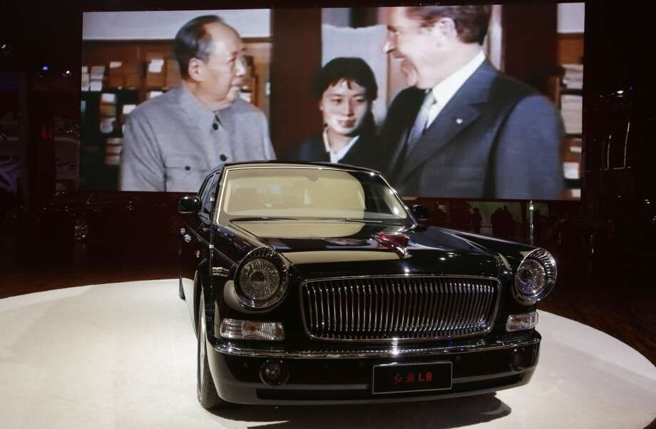 "FAW Hongqi ""Red Flag"" L9 is displayed at the Shanghai International Automobile Industry Exhibition (AUTO Shanghai) in Shanghai, China Sunday, April 21, 2013. (AP Photo/Eugene Hoshiko)"
