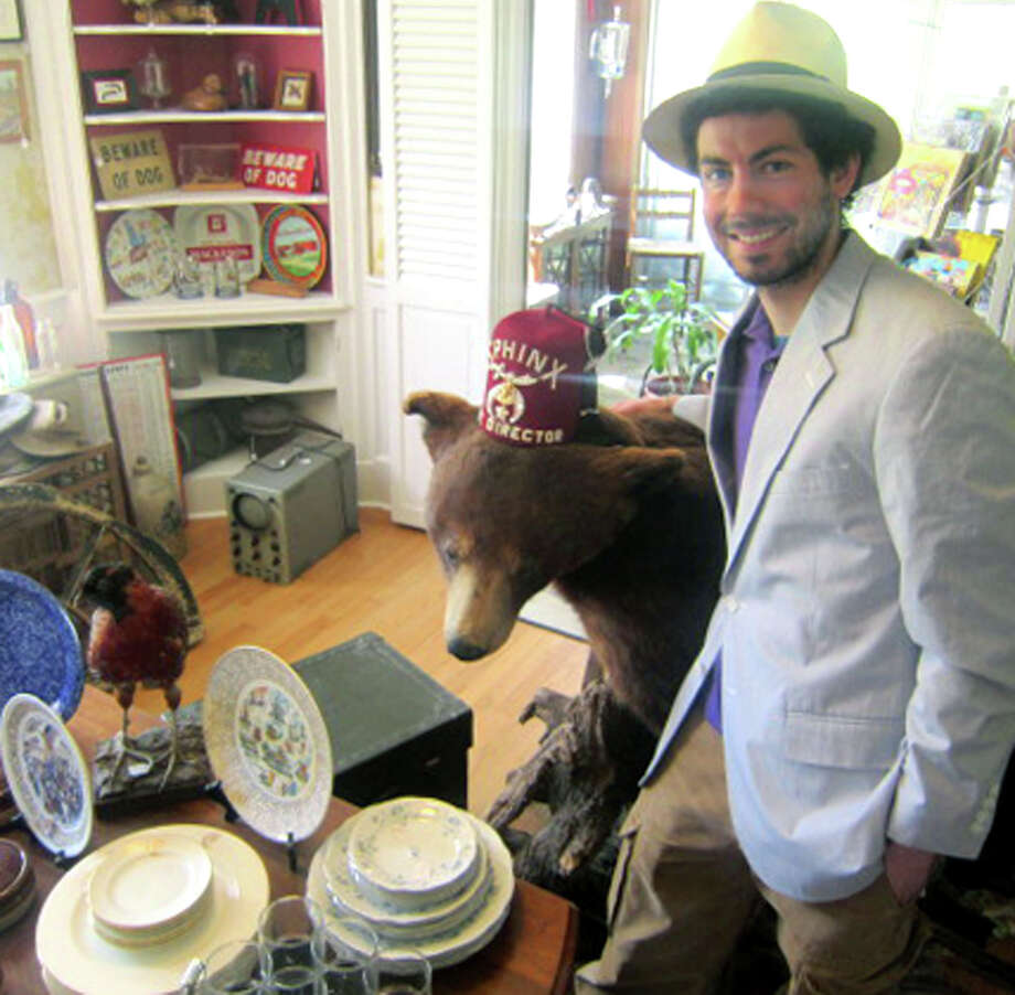 Sporting a fedora that's very much for sale, Justin Krul stands alongside a bear decked out in a colorful fez. Owner of Just In Antiques & More, he has found a home for himself, and his business, at 487 Danbury Road (Route 7 South) in New Milford. May 2013 Photo: Norm Cummings