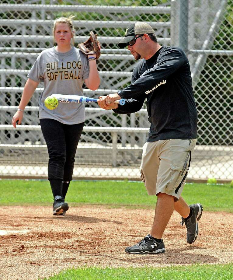 Nederland High School softball coach Will Mallette, right, works with infielders on fielding ground balls during practice on Wednesday, May 1, 2013. Photo taken: Randy Edwards/The Enterprise Photo: Randy Edwards