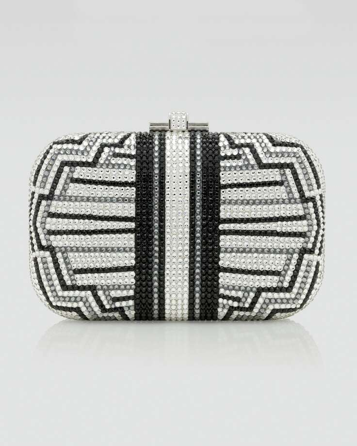 Skyscraper style: The Austrian crystals set in Judith Leiber's clutch mimic the dramatic lines of the Chrysler Building, and with the name Charleston, you know it was designed to encourage dancing; $2,695 at neimanmarcus.com.