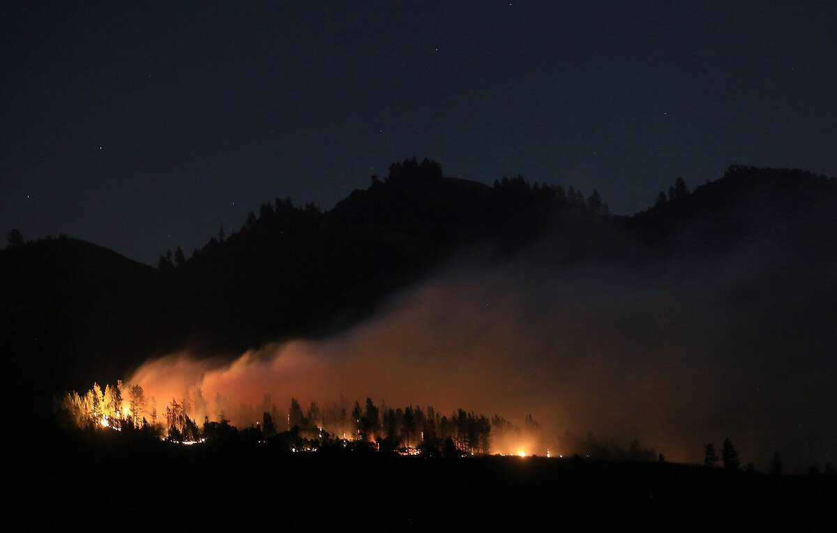 A wind driven vegetation fire eats up timber at the Yellow Jacket Ranch east of Highway 128, early Wednesday May 1, 2013 in Knights Valley, Calif., on the Napa and Sonoma County line. Crews battled two small wildfires on Wednesday in California wine country that were pushed by gusty winds.