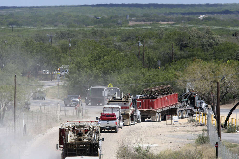 Oil field-related traffic on Old Fowlerton Road merges with Texas 16 in Tilden. Roads on the Eagle Ford Shale have taken a beating since the oil boom arrived. Photo: Express-News File Photo