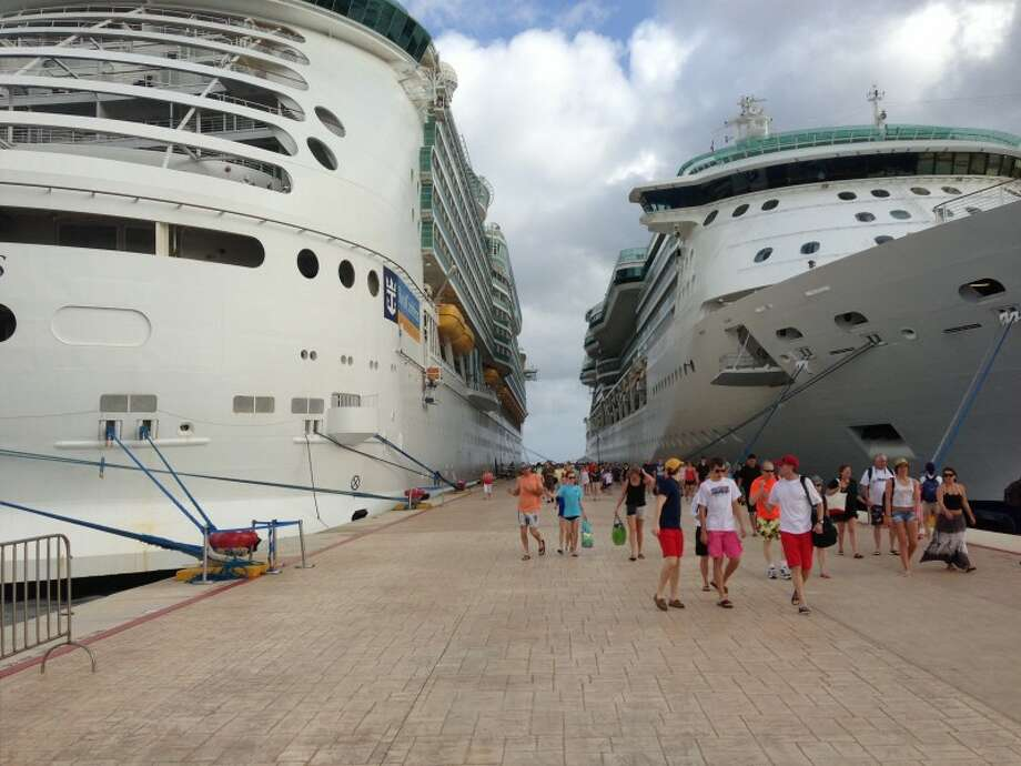 Travelers disembark from the Royal Caribbean Navigator of the Seas in one of the three ports where our cruise stopped: Cozumel, Grand Cayman and Jamaica.  Alec Harvey/Special to the Houston Chronicle Photo: CHRON