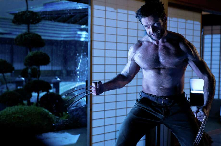 """The Wolverine"" — July 26: Wolverine (Hugh Jackman) pops his razor-sharp claws and pecs in modern Japan to slash his way through enemies, be they pesky ninjas or the villainous Silver Samurai (Will Yun Lee). Photo: McClatchy-Tribune News Service"