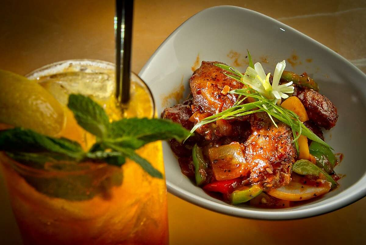 The Bombay Spiced Chicken Wings with the Pimm's on Amber cocktail at Amber India in San Francisco, Calif., is seen on Saturday, December 17th, 2011.