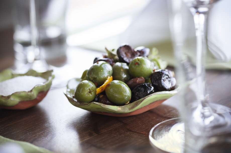 Olives and salt at Cindy's Waterfront, served in pottery made by Pawlcyn.