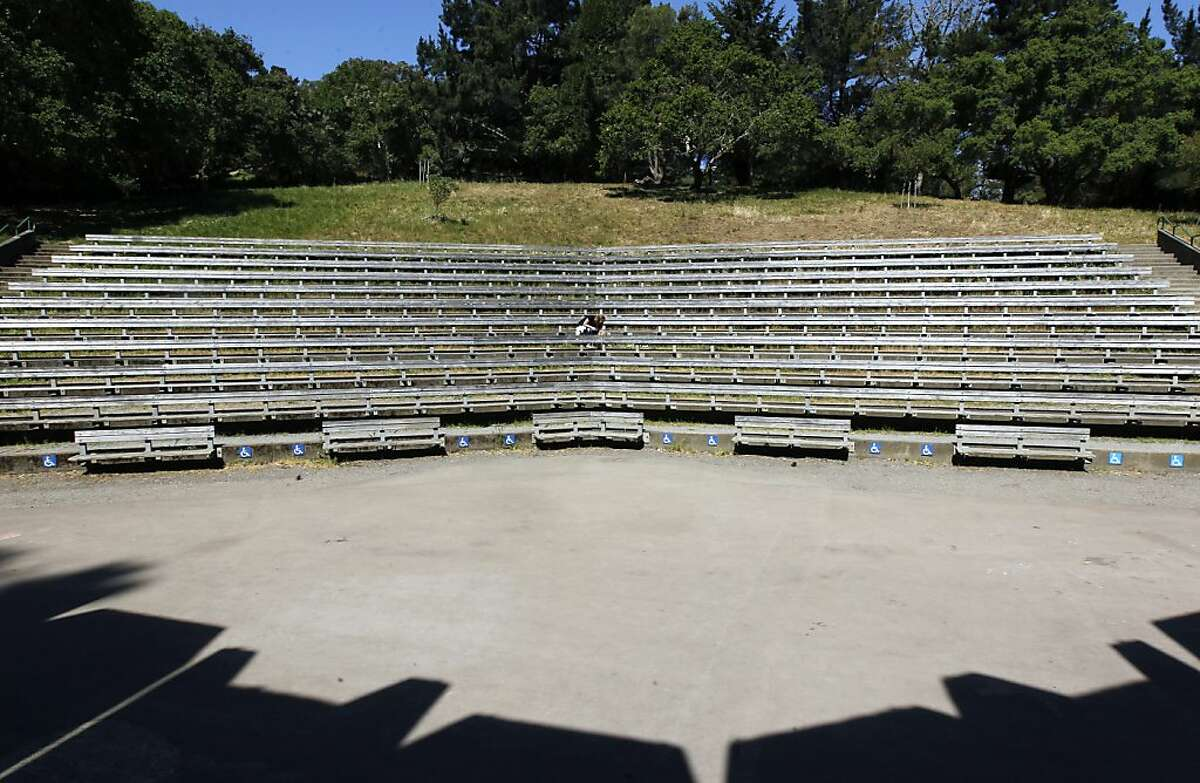 Tammy Weist and her son Kian sit at the center of the Jerry Garcia Amphitheater at McLaren Park in San Francisco, Calif. on Wednesday, May 1, 2013. Talks are underway with a Southern California nonprofit to renovate the theater but neighbors aren't happy with a proposed name change that goes with it.