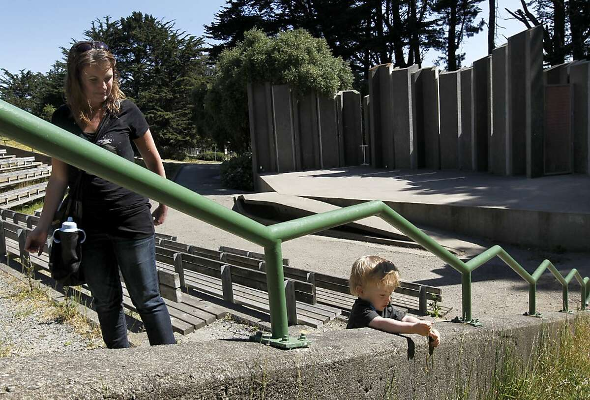 Tammy Weist and her son Kian climb the steps of the Jerry Garcia Amphitheater at McLaren Park in San Francisco, Calif. on Wednesday, May 1, 2013. Talks are underway with a Southern California nonprofit to renovate the theater but neighbors aren't happy with a proposed name change that goes with it.