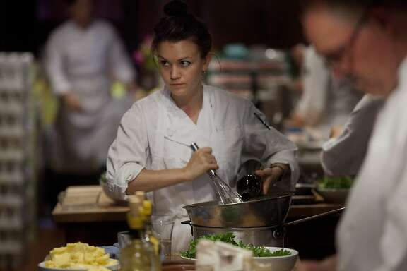 Sylvie Osborne-Calierno, line cook, mixes ingredients for the first course of meal at Chez Panisse on Thursday August 4, 2011 in Berkeley Calif.