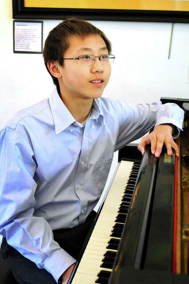 Luke Wang, 15, prepares to perform on piano for the Richter Arts Association, at Richter House in Danbury, Conn. Saturday, April 6, 2013. Photo: Michael Duffy / The News-Times