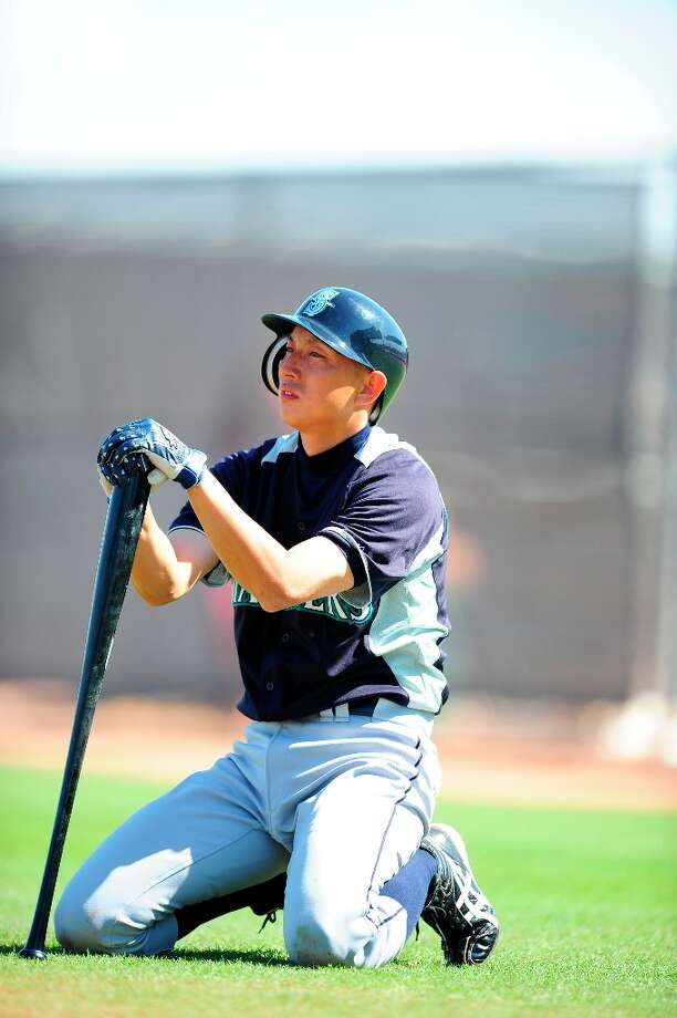 Munenori Kawasaki #61 of the Seattle Mariners practices during a  workout session at the Peoria Sports Complex on February 27, 2012 in Peoria, Arizona. Photo: Rob Tringali, Getty Images / 2012 Getty Images