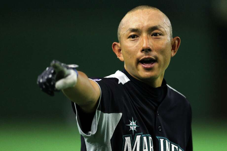 Infielder Munenori Kawasaki #61 of Seattle Mariners looks on during the warms up prior to the pre season game between Seattle Mariners and Hanshin Tigers at Tokyo Dome on March 25, 2012 in Tokyo, Japan. Photo: Koji Watanabe, Getty Images / 2012 Getty Images