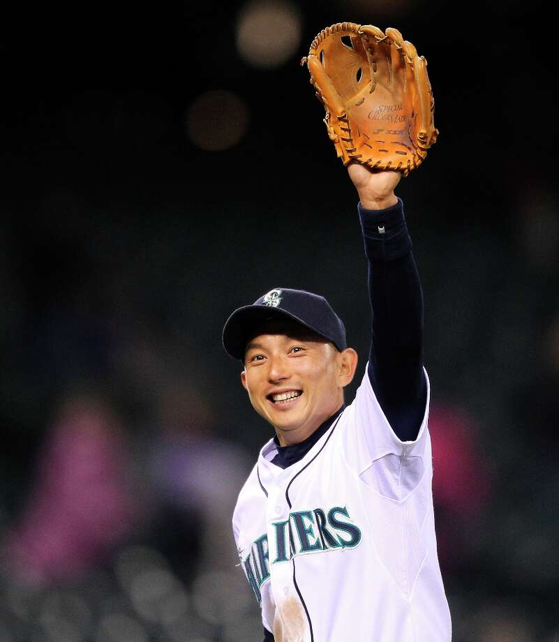 Munenori Kawasaki #61 of the Seattle Mariners waves to the crowd as he leaves the field after defeating the Cleveland Indians 4-1 at Safeco Field on April 18, 2012 in Seattle, Washington. Photo: Otto Greule Jr, Getty Images / 2012 Getty Images
