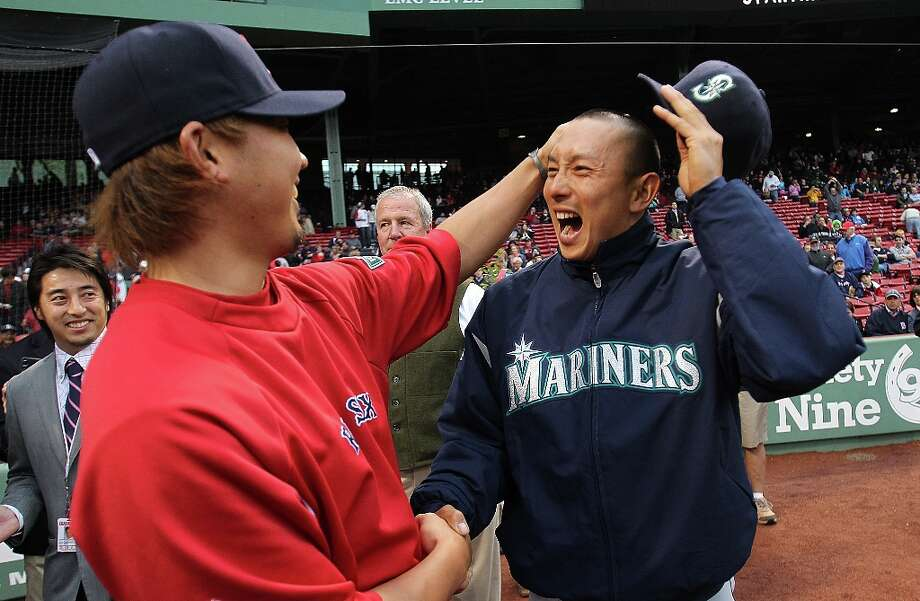 Daisuke Matsuzaka #18 of the Boston Red Sox chats with Munenori Kawasaki #61 of the Seattle Mariners before a game at Fenway Park May 14, 2012  in Boston, Massachusetts. Photo: Jim Rogash, Getty Images / 2012 Getty Images