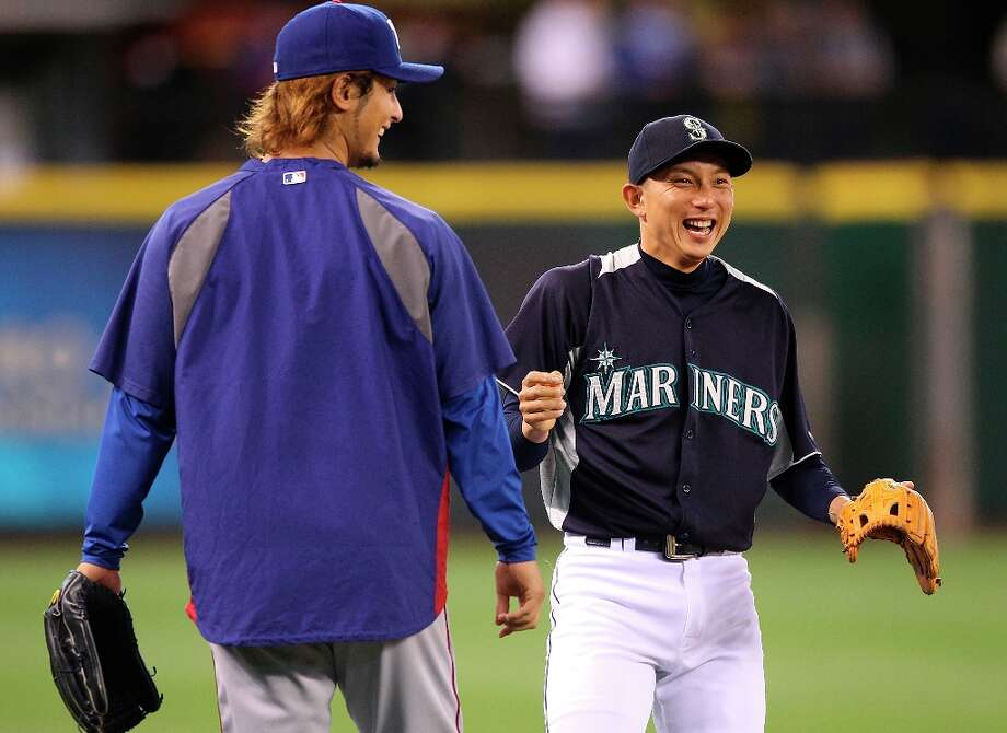 Starting pitcher Yu Darvish #11 (L) of the Texas Rangers visits with Munenori Kawasaki #61 of the Seattle Mariners during batting practice prior to the game at Safeco Field on May 22, 2012 in Seattle, Washington. Photo: Otto Greule Jr, Getty Images / 2012 Getty Images