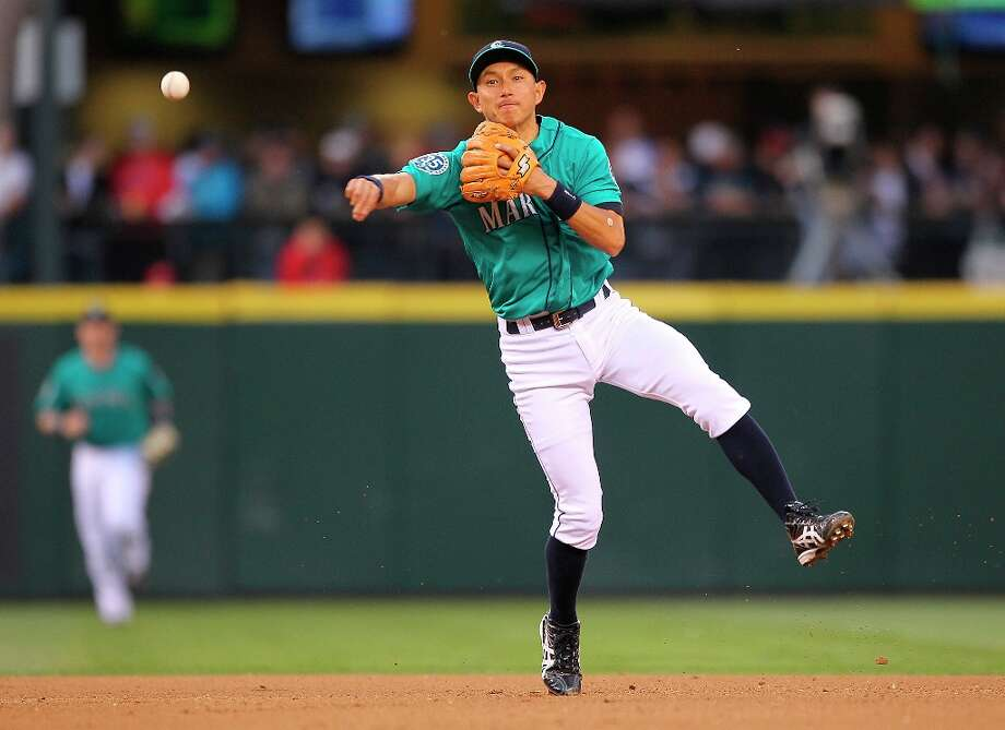 Shortstop Munenori Kawasaki #61 of the Seattle Mariners throws to first on a ground out by Kendrys Morales of the Los Angeles Angels of Anaheim in the fourth inning at Safeco Field on May 25, 2012 in Seattle, Washington. Photo: Otto Greule Jr, Getty Images / 2012 Getty Images