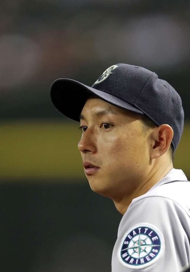 Munenori Kawasaki #61 of the Seattle Mariners watches from the dugout during the interleague MLB game against the Arizona Diamondbacks at Chase Field on June 18, 2012 in Phoenix, Arizona. The Diamondbacks defeated the Mariners 7-1. Photo: Christian Petersen, Getty Images / 2012 Getty Images