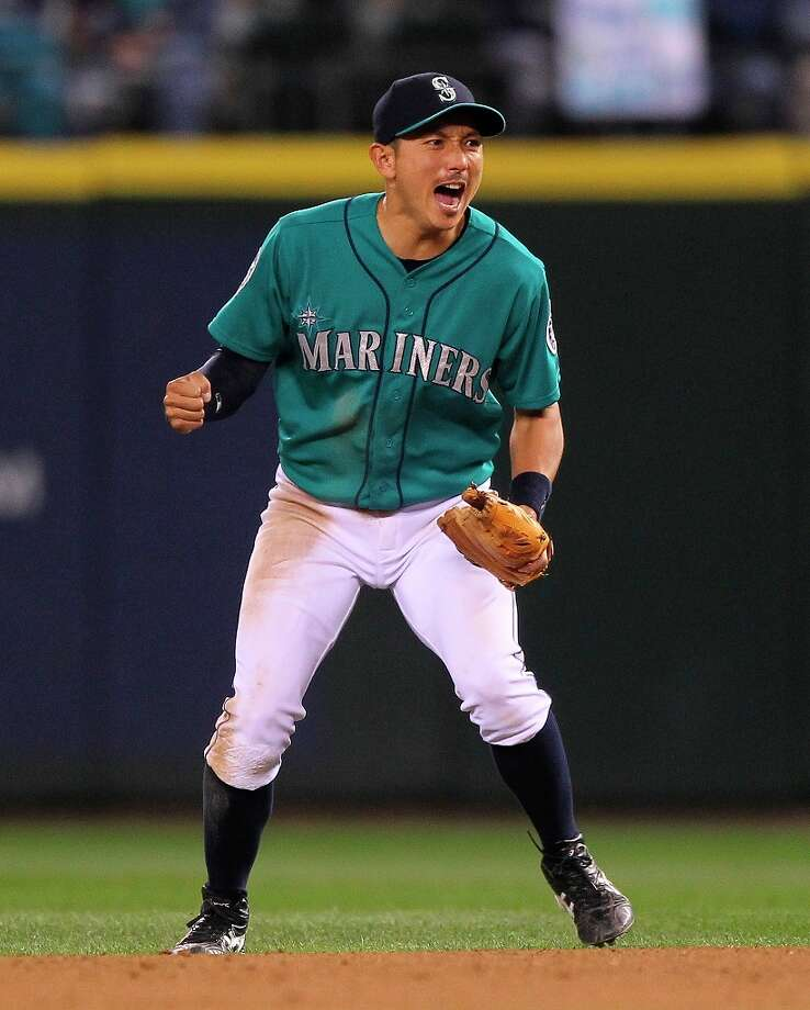Second baseman Munenori Kawasaki #61 of the Seattle Mariners reacts as the Mariners get the last out of the eighth inning against the Baltimore Orioles at Safeco Field on July 2, 2012 in Seattle, Washington. The Mariners defeated the Orioles 6-3. Photo: Otto Greule Jr, Getty Images / 2012 Getty Images