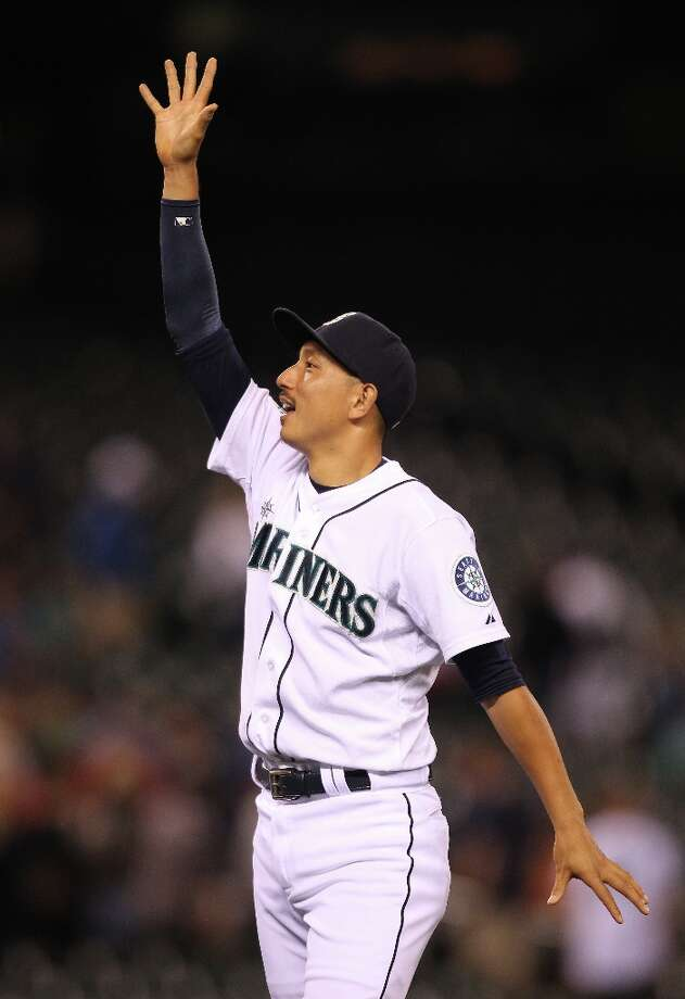 Munenori Kawasaki #61 of the Seattle Mariners waves to the crowd after defeating the Kansas City Royals 4-1 at Safeco Field on July 26, 2012 in Seattle, Washington. Photo: Otto Greule Jr, Getty Images / 2012 Getty Images