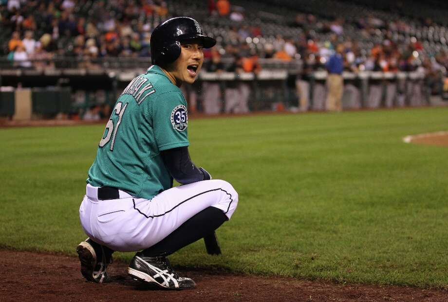 Munenori Kawasaki #61 of the Seattle Mariners waits to hit in the on deck circle in the ninth inning against the Baltimore Orioles at Safeco Field on September 17, 2012 in Seattle, Washington. The Orioles defeated the Mariners 10-4. Photo: Otto Greule Jr, Getty Images / 2012 Getty Images