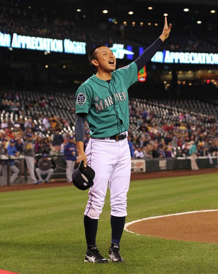 Munenori Kawasaki #61 of the Seattle Mariners acknowledges the crowd after receiving the MLB Heart and Hustle award prior to the game against the Texas Rangers at Safeco Field on September 21, 2012 in Seattle, Washington. Photo: Otto Greule Jr, Getty Images / 2012 Getty Images