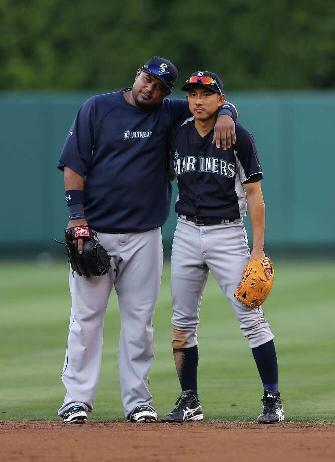 Luis Jimenez (L) #39 of the Seattle Mariners puts his arm around Munenori Kawasaki #61 prior to the start of the game against the Los Angeles Angels of Anaheim at Angel Stadium of Anaheim on September 25, 2012 in Anaheim, California. Photo: Jeff Gross, Getty Images / 2012 Getty Images