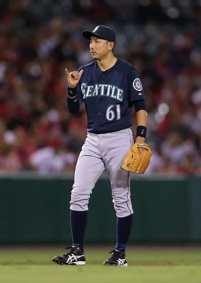 Shortstop Munenori Kawasaki #61 of the Seattle Mariners gestures in the eighth inning against the Los Angeles Angels of Anaheim at Angel Stadium of Anaheim on September 25, 2012 in Anaheim, California. The Angels defeated the Mariners 5-4. Photo: Jeff Gross, Getty Images / 2012 Getty Images
