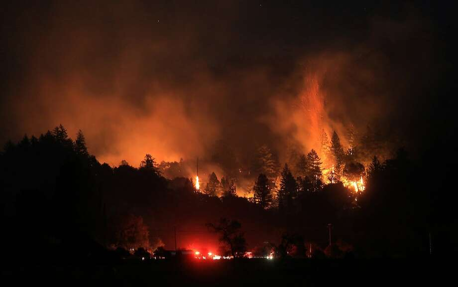 A wind driven vegetation fire eats up timber  at the Yellow Jacket Ranch east of Highway 128, early Wednesday May 1, 2013 in Knights Valley, Calif., on the Napa and Sonoma County line. Crews battled two small wildfires on Wednesday in California wine country that were pushed by gusty winds. (AP Photo/The Press Democrat, Kent Porter) Photo: Kent Porter, Associated Press