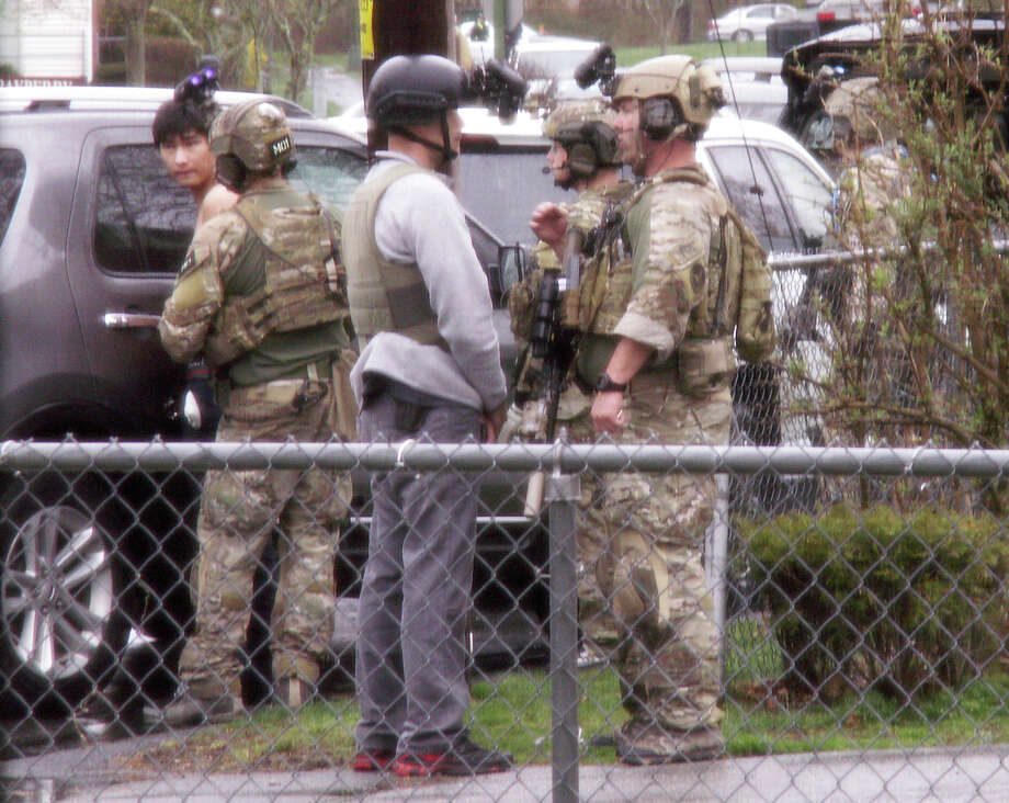 Officerss take Dias Kadyrbayev, left, in for questioning on April 19 after the bombing of the Boston Marathon. Kadyrbayev is now charged with obstruction. Photo: Darlene Rymszewicz / Darlene Rymszewicz