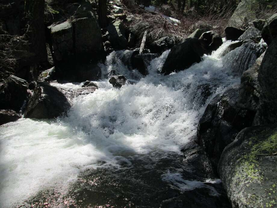 One of a dozen small waterfalls you pass