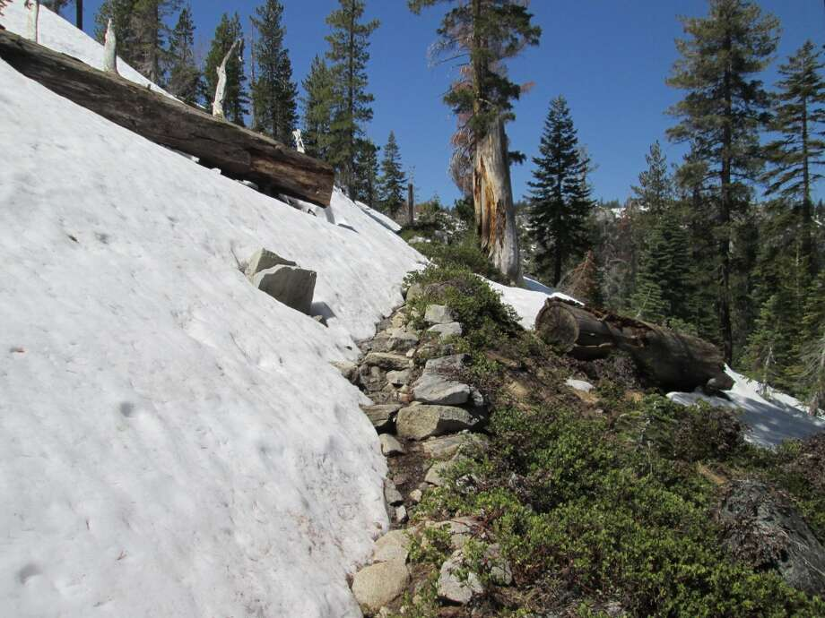 At 7,000 feet, you hit snow, where it edges the trail before you turn left into the basin headwaters and to . . .