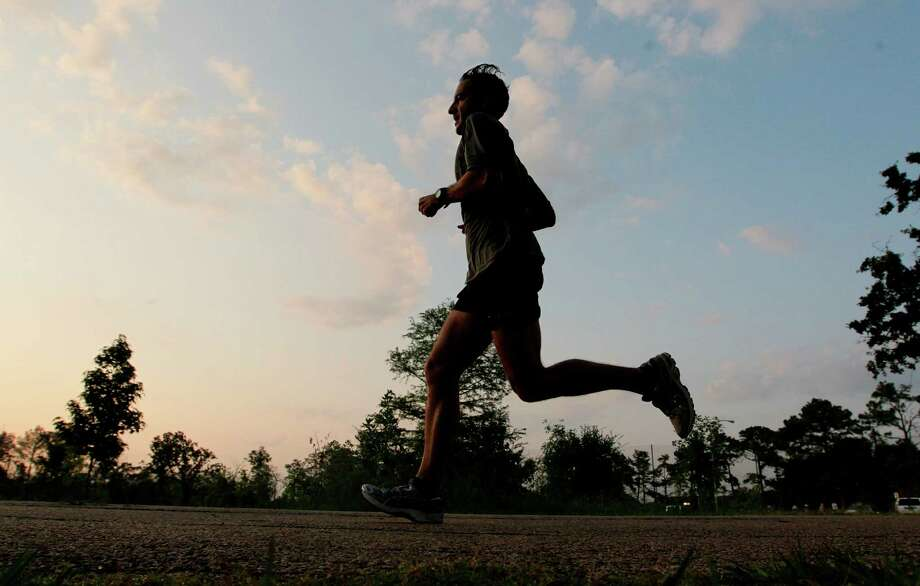 Runner Eric Cassidy enjoys a partly cloudy morning at Memorial Park on Monday, May 21, 2012, in Houston. (Mayra Beltran / Houston Chronicle ) Photo: Mayra Beltran, Staff / Houston Chronicle