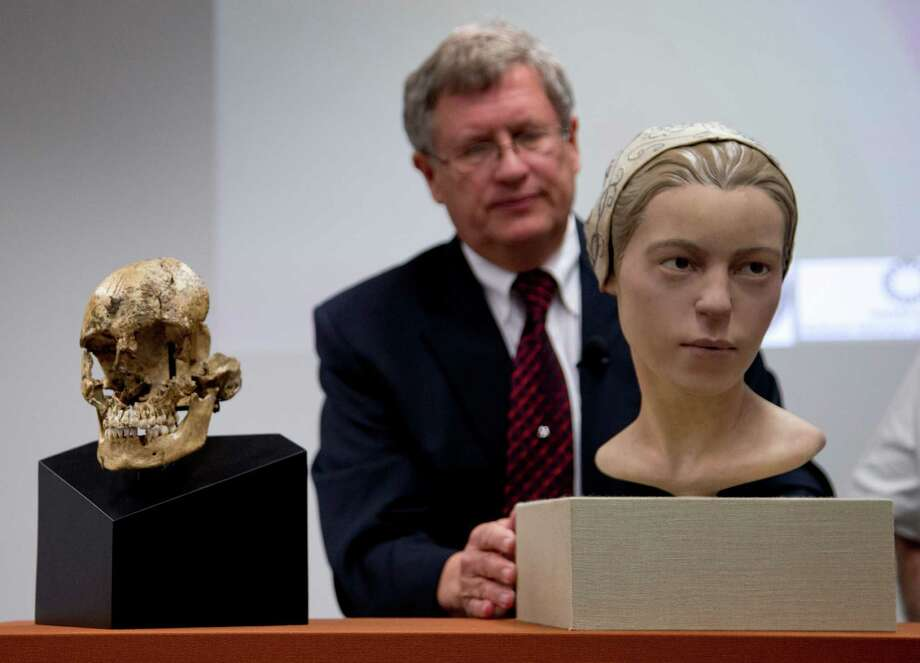 """The Smithsonian Institution's Doug Owsley  displays the skull and facial reconstruction of  """"Jane of Jamestown""""  at the museum in Washington on Wednesday. Photo: Carolyn Kaster, STF / AP"""