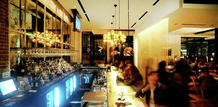 Triniti, on South Shepherd, has a redesigned bar area. It serves up craft cocktails such as the Broken Clock and the Big Apricot. Photo: Debora Smail / Debora Smail