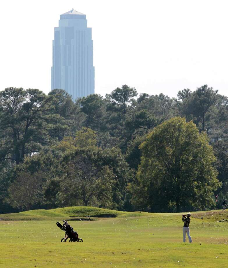A women hits the ball on the 13th hole during a round of golf at Memorial Park Golf Course Thursday, Nov. 15, 2012, in Houston.    ( James Nielsen / Chronicle ) Photo: James Nielsen, Staff / © Houston Chronicle 2012