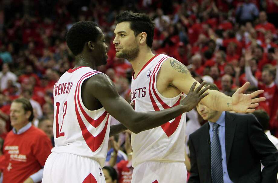At 6-1 and 185 pounds, Rockets point guard Patrick Beverly, left, with teammate Carlos Delfino, is a perfect example of the smaller players teams are inserting into their lineups to create scoring opportunities when facing lengthier teams like the Thunder. Photo: James Nielsen, Staff / © 2013  Houston Chronicle