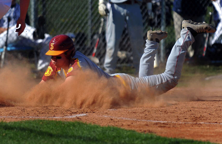 St. Joseph's Brett Olayos slides head first into home plate to score, during baseball action against Staples in Westport, Conn. on Wednesday May 1, 2013. Photo: Christian Abraham / Connecticut Post