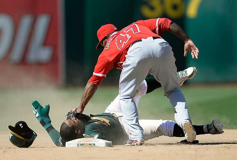 OAKLAND, CA - MAY 01:  Yoenis Cespedes #52 of the Oakland Athletics attempting to steal over slides second base and gets tagged out by Howie Kendrick #47 of the Los Angeles Angels of Anaheim in the ninth inning at O.co Coliseum on May 1, 2013 in Oakland, California. The Angels won the game 5-4. (Photo by Thearon W. Henderson/Getty Images) Photo: Thearon W. Henderson, Getty Images
