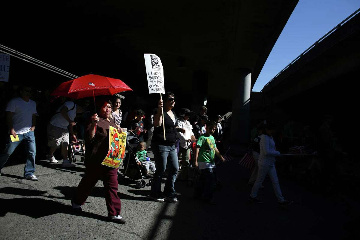 People march under Interstate 5 during an immigrant rights May Day rally.