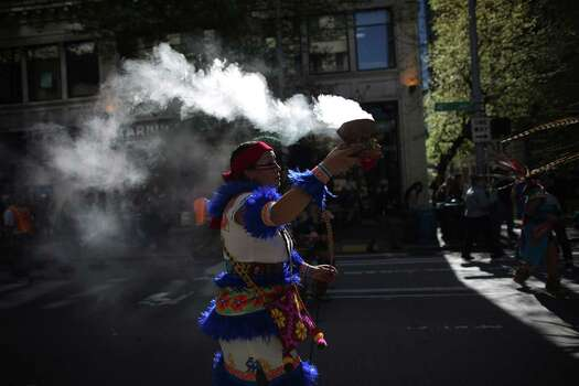 An Aztec dancer burns incense during an immigrant rights May Day march through downtown Seattle. Photo: JOSHUA TRUJILLO, SEATTLEPI.COM / SEATTLEPI.COM