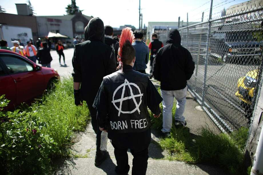 Anarchists walk alongside during an immigrant rights May Day rally in Seattle on Wednesday, May 1, 2013. Thousands of people marched, demanding immigration reform. A handful of black-clad protesters participated but the march was peaceful. Photo: JOSHUA TRUJILLO, SEATTLEPI.COM / SEATTLEPI.COM