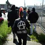 Anarchists walk alongside other marchers during an immigrant rights May Day march.