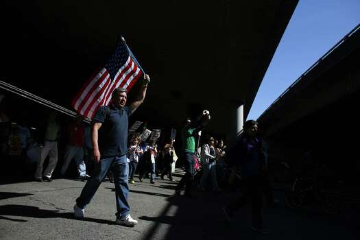 Marchers make their way under Interstate 5. Photo: JOSHUA TRUJILLO, SEATTLEPI.COM / SEATTLEPI.COM