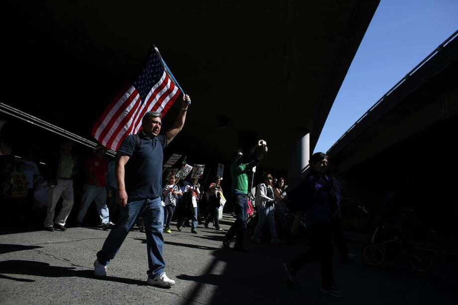 Marchers make their way under Interstate 5. Photo: JOSHUA TRUJILLO, SEATTLEPI.COM / SEATTLEPI.COM