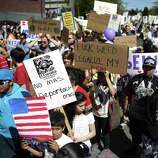 Marchers kickoff an immigrant rights May Day rally and march near Judkins Park.