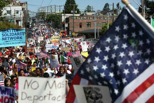 People march down Jackson Street during an immigrant rights May Day rally. Photo: JOSHUA TRUJILLO, SEATTLEPI.COM / SEATTLEPI.COM