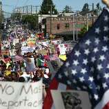 People march down Jackson Street during an immigrant rights May Day rally.