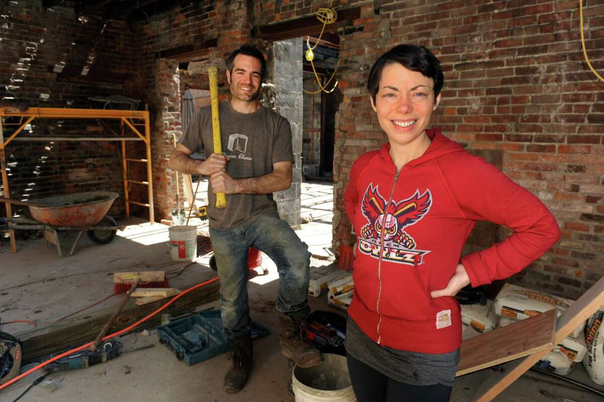 Vic Christopher, left, and Heather LaVine, his wife, at the rehab site of their new business, The Grocery, on Wednesday, May 1, 2013, Troy, N.Y. (Cindy Schultz / Times Union)